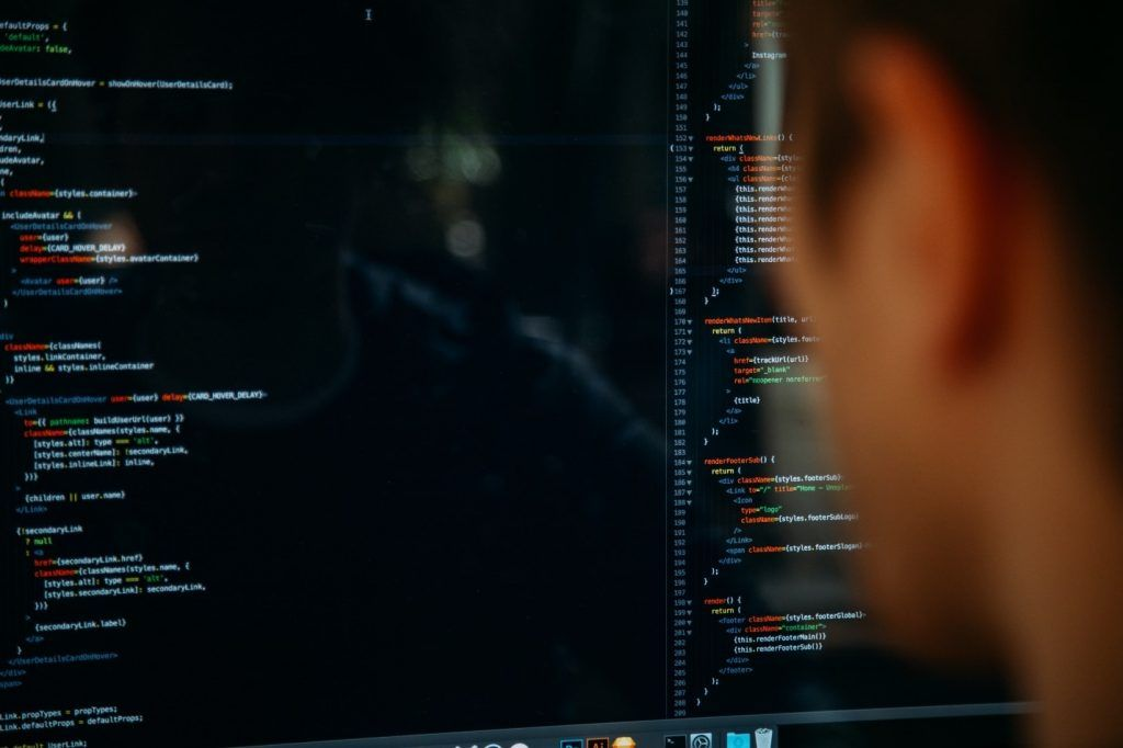 Man looking computer screen with code, sql group by